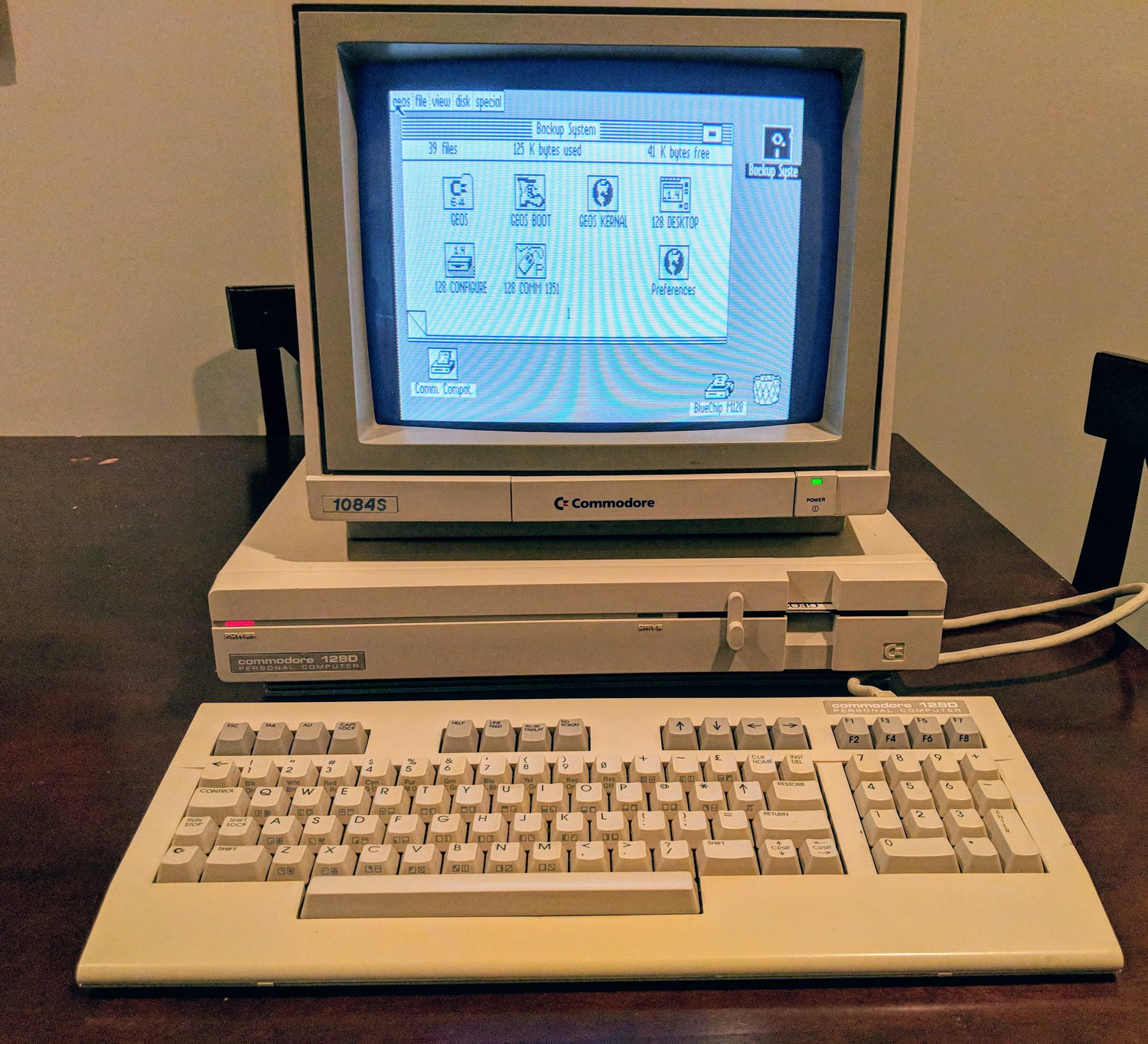 Commodore 128D, powered up with a 1084S monitor running GEOS 128