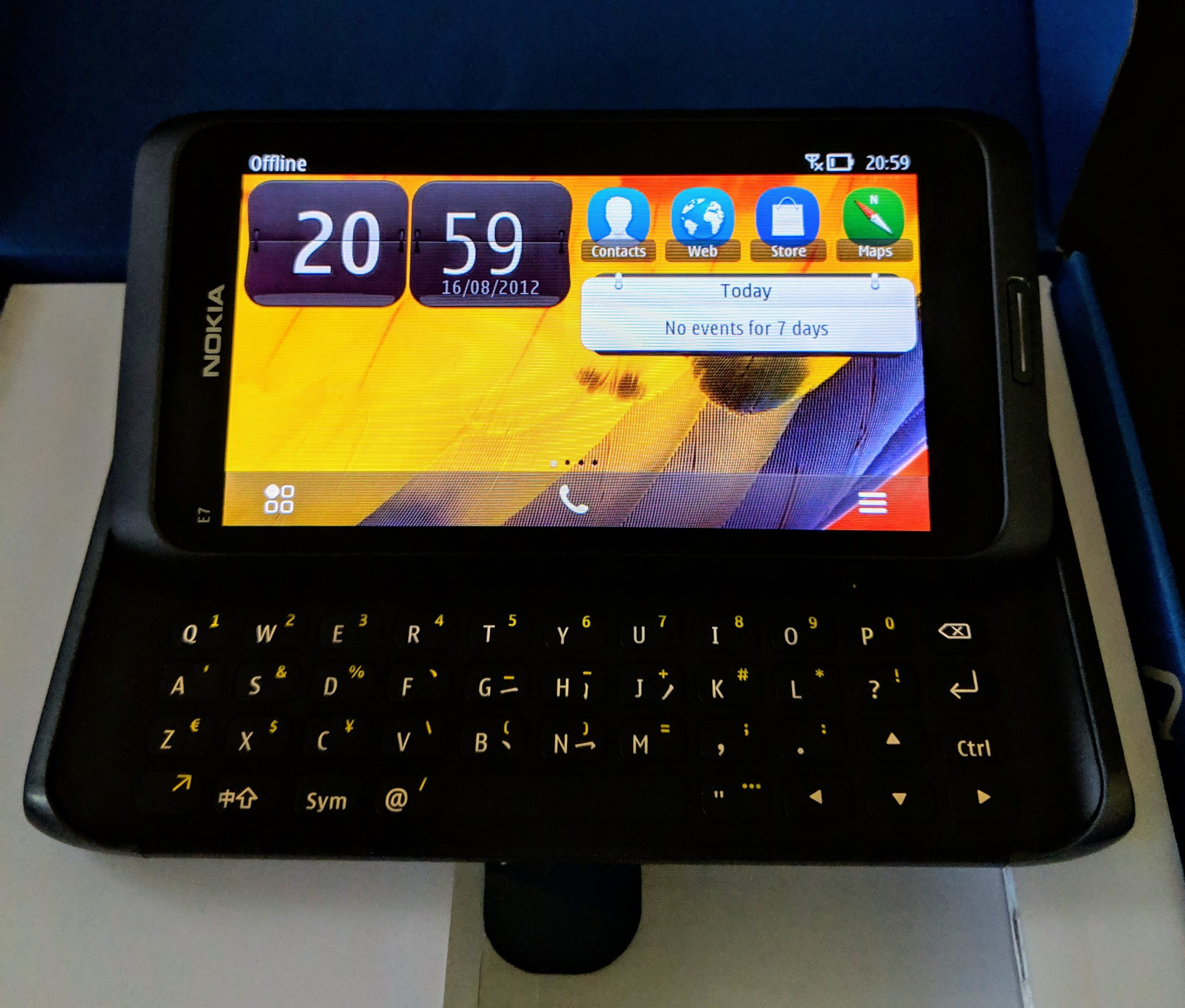 Nokia E7 in landscape orientation, keyboard out, and powered on